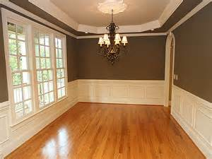 chocolate walls and wainscoting dining room remodeling traditional dining room with hardwood floors amp wainscoting