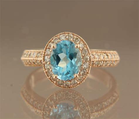 Blue Topaz 1 48 Carat no reserve price 14 kt gold entourage ring with 1