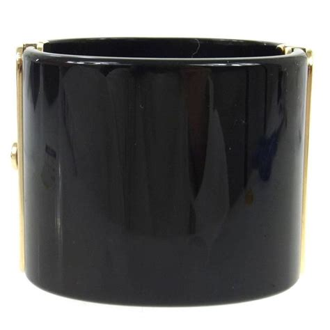 A25 Bangle For Luxury Evening chanel black gold quilted charm statement evening cuff