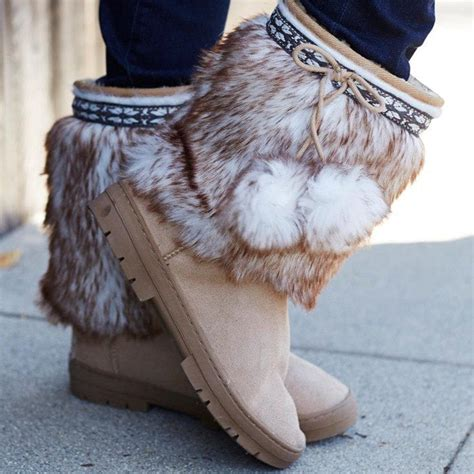 fuzzy winter boots fuzzy pom pom boots for winter in black and blue
