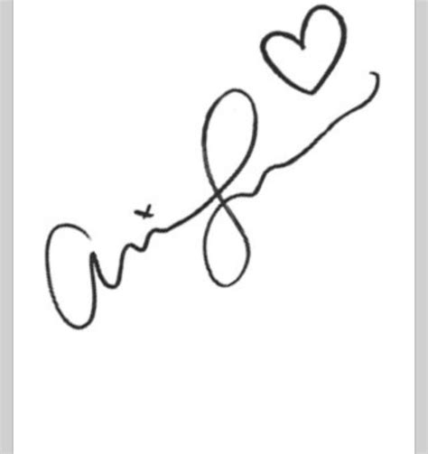 arianas autograph would be a cute tattoo ariana grande