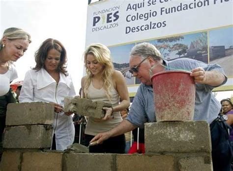 shakira fashion line facts shakira visits under construction school funded by her