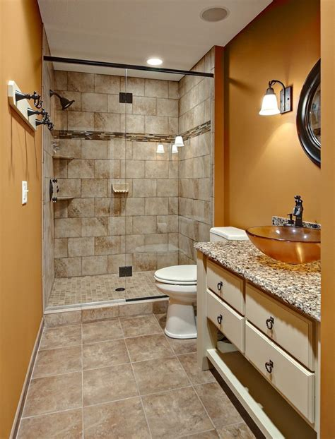 earth tone tile bathrooms bathroom traditional with grey