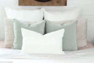bed with a lot of pillows how to arrange euro shams on your bed for perfect bedding
