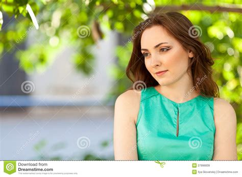 beautiful woman by the tree looking up stock photo image beautiful woman looking down outdoors royalty free stock
