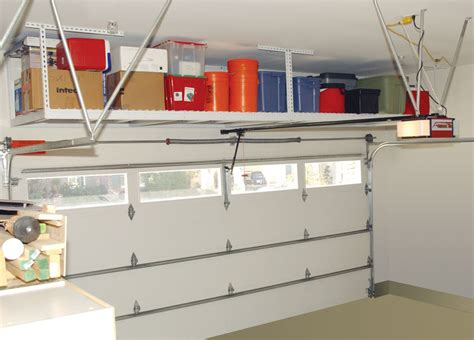 Overhead Garage Door Storage Saferacks Storage Solutions Overhead Ceiling Mounted Garage Racks And Shelves