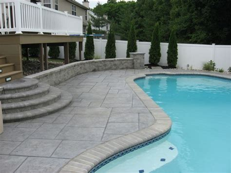 imposing pavers  stamped concrete  pool