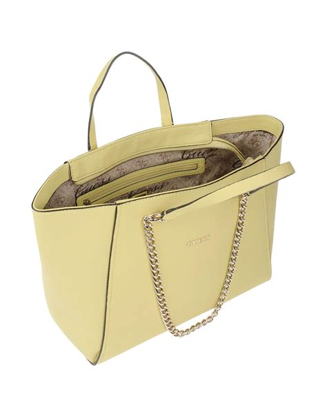 Guess Who The Louis Vuitton Purse by Lyst Guess Handbag In Yellow