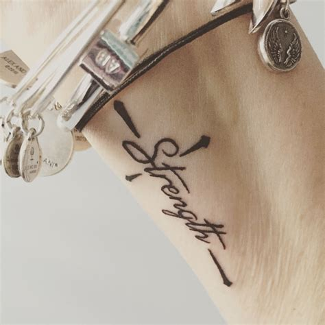 cross tattoo with words my wrist the word quot strength quot in a cross my