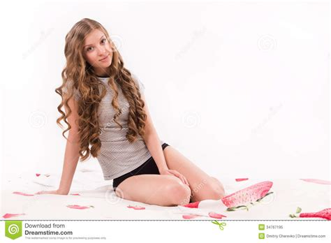 girl sitting on bed pretty girl sitting on the bed royalty free stock photo image 34767195