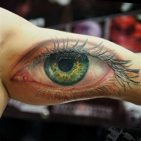 realistic human eye on guys bicep best tattoo design ideas