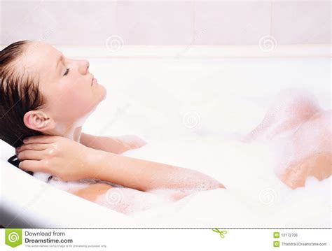 bathtub foam young woman enjoys the bath foam royalty free stock image