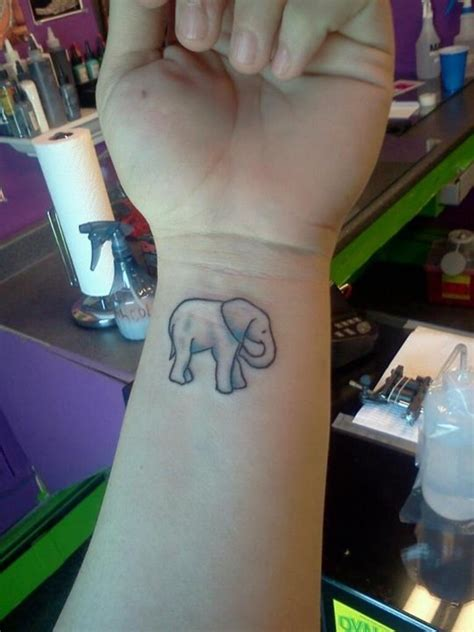 45 elephant tattoos designs on wrists