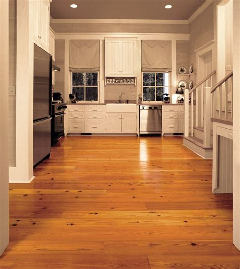 antique reclaimed pine solid wood flooring in a contemporary kitchen stainless steel