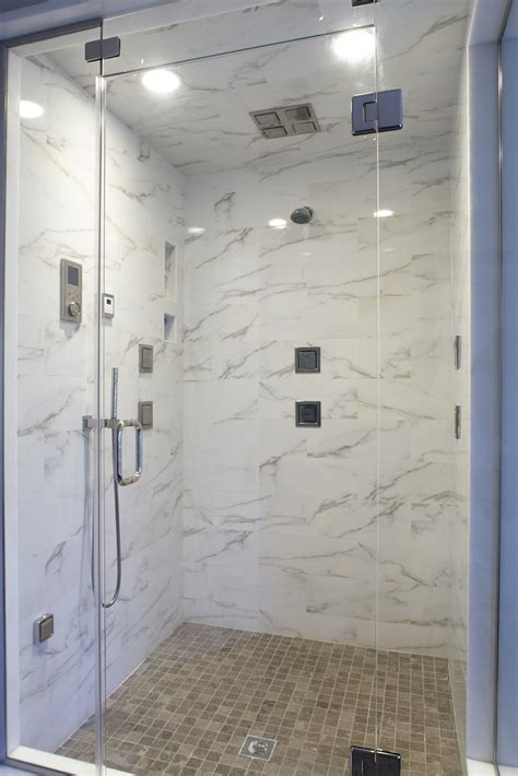 Master shower with steam unit, rain shower head and tile body sprays.   Puleo Plumbing & Heating