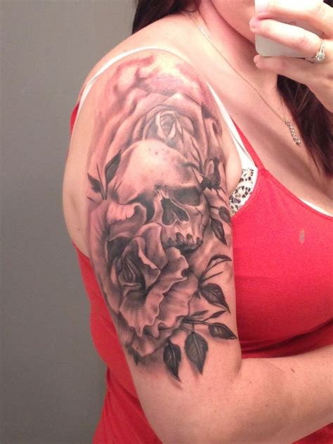 start to a sleeve tattoo skull flowers tattoos