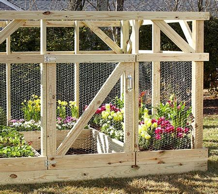 white garden enclosure built by home depot garden