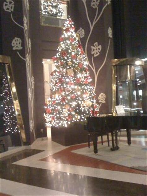 the piano and the christmas tree at lobby picture of