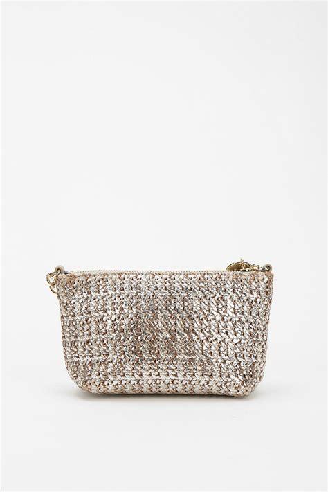 deux metallic straw crossbody bag in metallic lyst