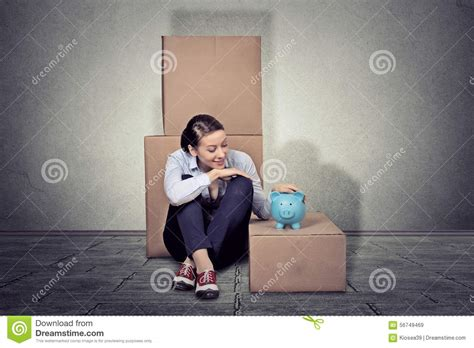 happy sitting on the floor with many boxes moving