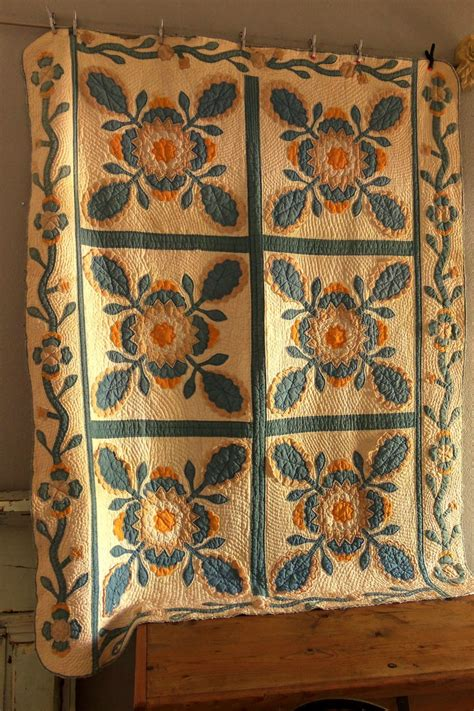 antique handmade squash blossom applique quilt blue