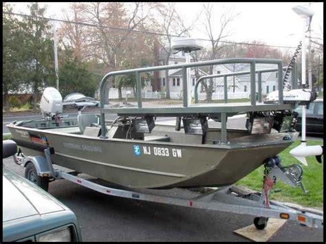 flat bottom bowfishing boat bowfishing boat with raised platform fisher woman