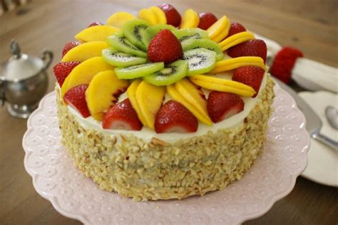 fluffy honey layer cake with fruit and almonds olga s flavor factory