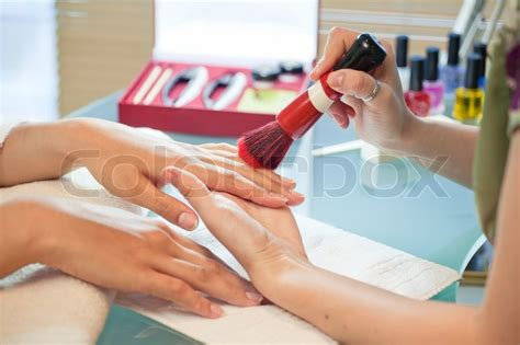 Manicure Pedicure Di Salon Malaysia manicure brush cleans nails in a salon manicure stock photo colourbox