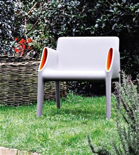 kartell magic hole outdoor chair surrounding com