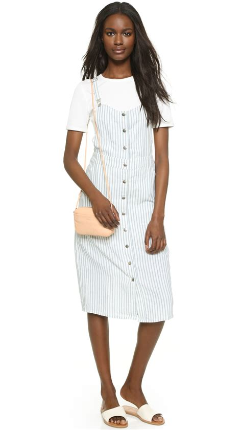 White Overall Dress capulet front button overall dress in white lyst