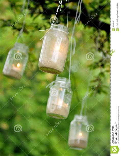 How To String Outdoor Party Lights - mason jar candles hanging from a tree royalty free stock photography image 28595257