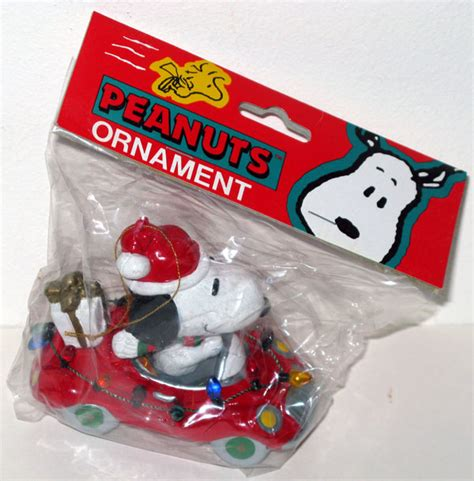 snoopy driving red car christmas ornament collectpeanuts com
