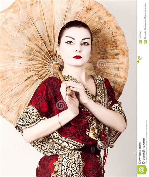 Eyeliner Kimono beautiful dressed as a geisha holding a umbrella geisha makeup and hair