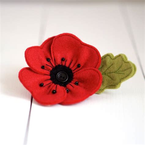 handmade red felt poppy brooch by rosiebull designs