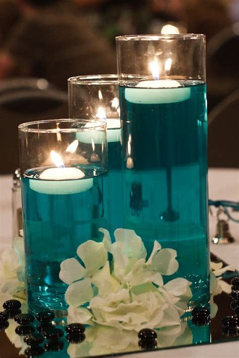 DIY centerpieces; water, food color, floating candle, cute