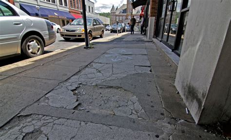 replacing sidewalk section businesses push for wider sidewalks streetside cafes
