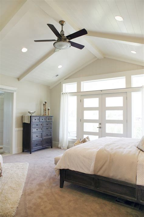 Master Bedroom, high ceiling, bright windows and a fan