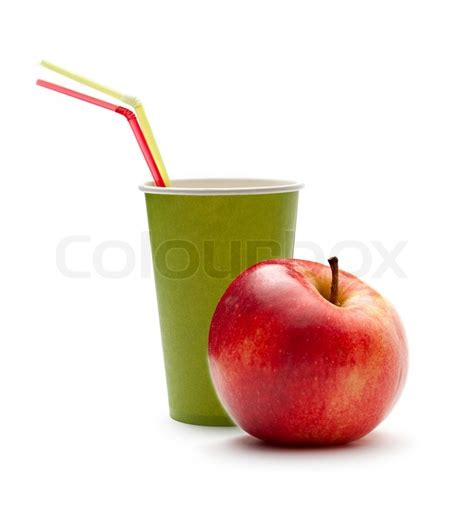paper cup with straws and apple stock photo colourbox