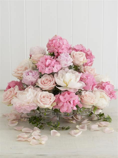 Floral Centerpieces by As A Cupcake A Wire Cupcake Stand Gives This