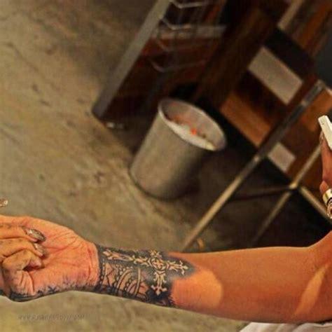 tattoo rihanna wrist rihanna elaborate cross tattoo on the inside of 4 ink