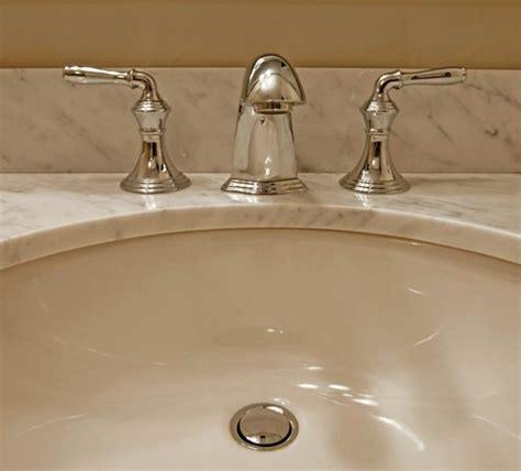 how to remove yellow stains from bathroom sink removing stains from a porcelain sink thriftyfun