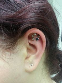 cat tattoo ear piercing prices and another paw print piercing idea body art pinterest