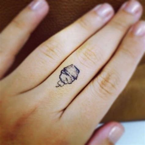 small cupcake tattoo picture of mini cupcake on the finger