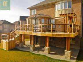 cedar deck with walkout basement and pergola traditional deck toronto by m e landscaping