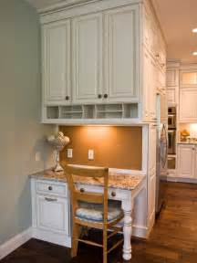 kitchen desk area with white cabinets and hardwood floor hgtv