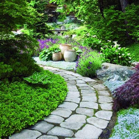 garden paths the use of hard surfaces and stones in garden design