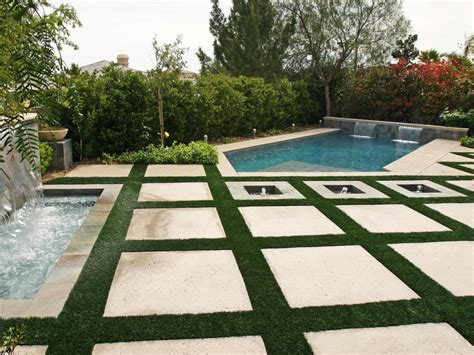 Large Patio Pavers Poolside Patio With Large Square Pavers The Polygon Shaped Pool Includes Two Mini Waterfalls And