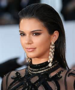 Kendall jenner wears a sheer snake covered dress at cannes instyle