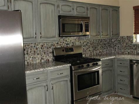 lynda bergman decorative artisan white kitchen cabinets white kitchen dark tile floors
