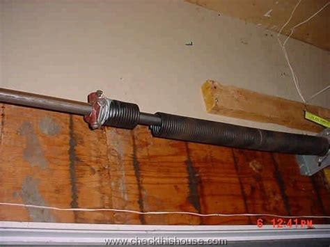 An Overhead Garage Door Has Two Springs by Protection From Roll Up Garage Door Failure